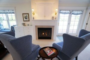 chairs and fireplace, mantle